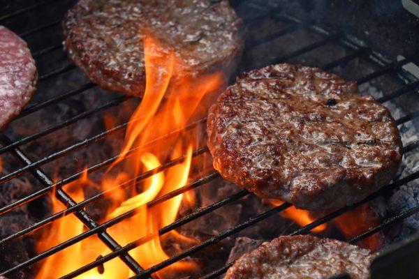 Beef burgers on bbq