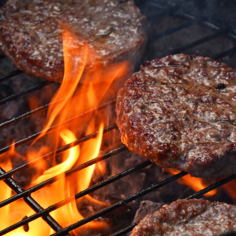 Beef burgers on bbq